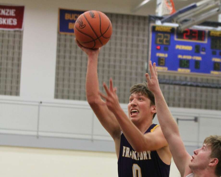 Jack Stefanski drives to the basket for a shot against the Portagers. Photo: Dylan Savela/Pioneer News Network