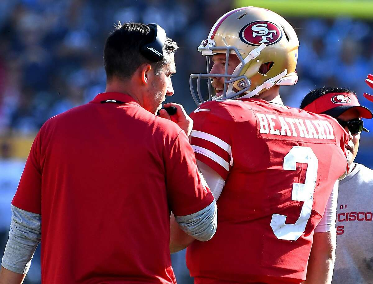 CARSON, CA - SEPTEMBER 30: Head coach Kyle Shanahan talks with quarterback C.J. Beathard #3 of the San Francisco 49ers during the fourth quarter of the game against the Los Angeles Chargers at StubHub Center on September 30, 2018 in Carson, California. (Photo by Jayne Kamin-Oncea/Getty Images)