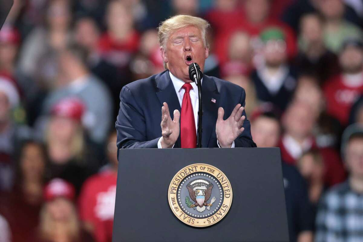 BATTLE CREEK, MICHIGAN - DECEMBER 18: President Donald Trump addresses his impeachment after learning how the vote in the House was divided during a Merry Christmas Rally at the Kellogg Arena on December 18, 2019 in Battle Creek, Michigan. While Trump spoke at the rally the House of Representatives voted, mostly along party lines, to impeach the president for abuse of power and obstruction of Congress, making him just the third president in U.S. history to be impeached. (Photo by Scott Olson/Getty Images)