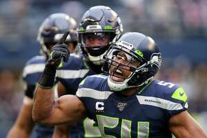 Seattle Seahawks middle linebacker Bobby Wagner (54) celebrates his second quarter sack of Arizona Cardinals quarterback Kyler Murray (1) during Seattle's game against Arizona, Sunday, Dec. 22, 2019.