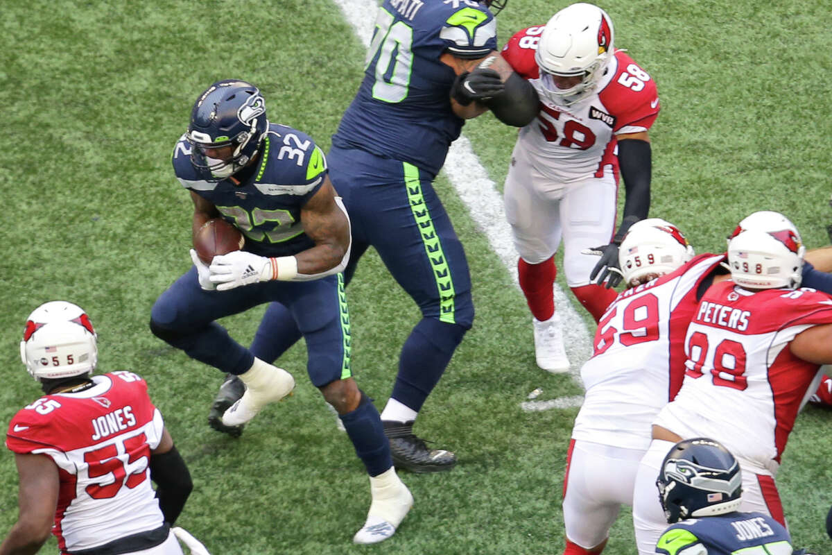 Seattle Seahawks running back Chris Carson (32) finds a hole and picks up a few yards before leaving the game due to an injury in the first quarter Seattle's game against Arizona, Sunday, Dec. 22, 2019.