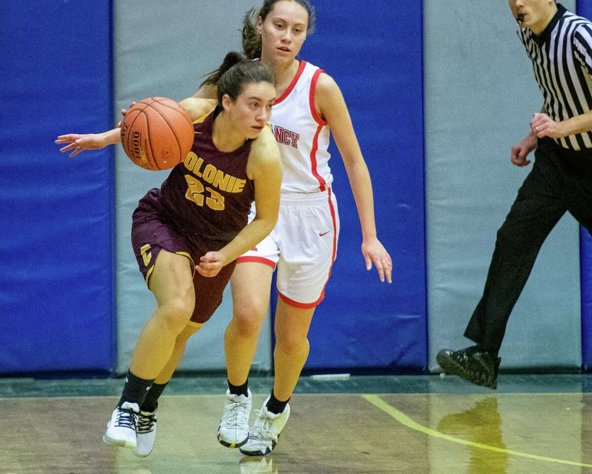 Colonie High senior Ahnalese Pearson past a Monsignor McClancy High School defender at Albany High School on Sunday, Dec. 22, 2019 (Jim Franco/Special to the Times Union.)