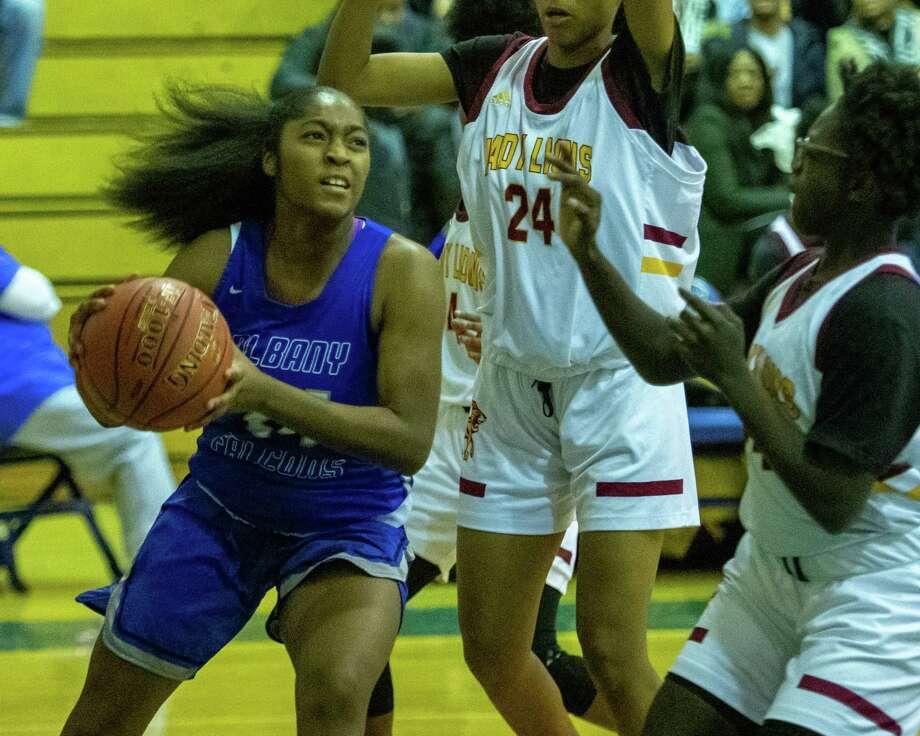 Albany High senior Ahniysha Jackson drives to the basket against Frederick Douglas Academy at Albany High on Sunday, Dec. 22, 2019 (Jim Franco/Special to the Times Union.) Photo: James Franco / 40048495A