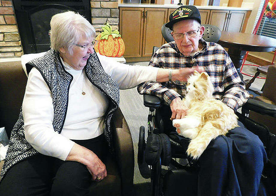 "Janice and Alonzo ""Don"" Parker get to know Don Parker's new robotic cat, which he named Jenny, at the Veterans Affairs Illiana Health Care System in Danville. Photo: Mary Wicoff 