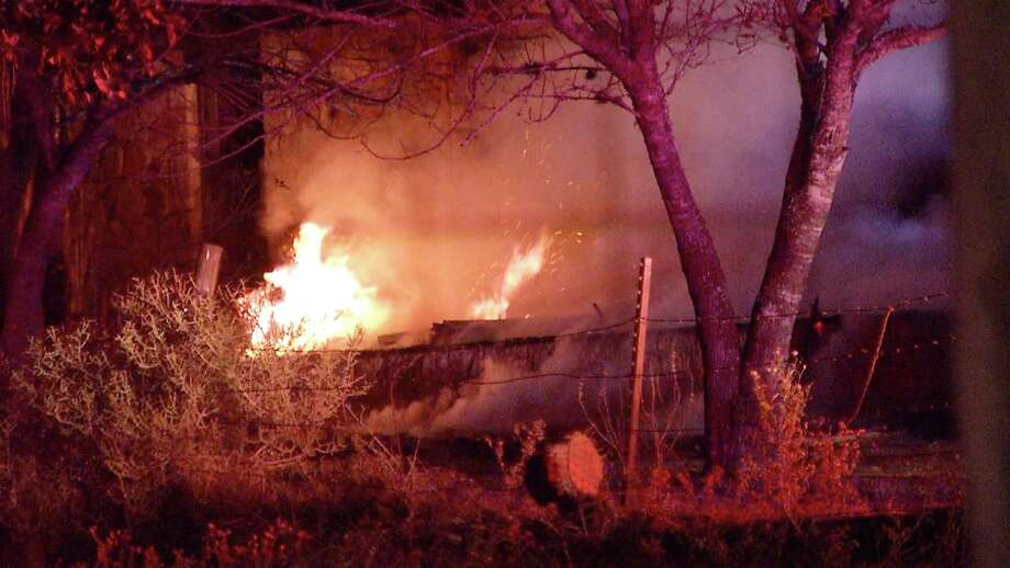 Three people escaped a house fire early Monday in Southeast Bexar County. Photo: Ken Branca
