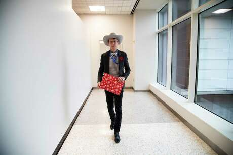 """Alton DuLaney, known as the """"world's most famous gift wrap artist,"""" who also holds the title of George Bush Intercontinental Airport's art curator on Friday, Dec. 20, 2019 at the George Bush Intercontinental Airport in Houston."""