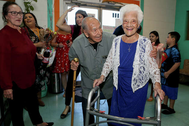 Ofelia Gonzales is met by an old friend, Cristobal Licea, 96, as she arrives to celebrate her 109th birthday with friends and family at Arizona Cafe on Thursday, Oct. 10, 2019. Gonzales is one of more than 70 million centenarians living in the United States. Photo: Marvin Pfeiffer / Express-News 2019