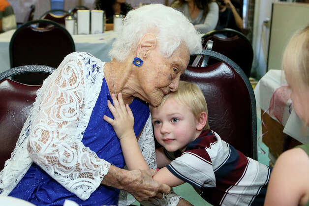 Ofelia Gonzales receives a hug from her 3-year-old great-great grandson Oakley Hancock while celebrating her 109th birthday with friends and family at Arizona Cafe. Photo: Marvin Pfeiffer / Express-News 2019