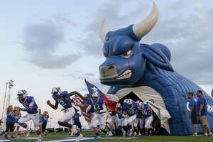 The MacArthur Brahmas take the field prior to the start of their District 27-6A high school football game with Roosevelt at Comalander Stadium on Friday, Sept. 20, 2019.