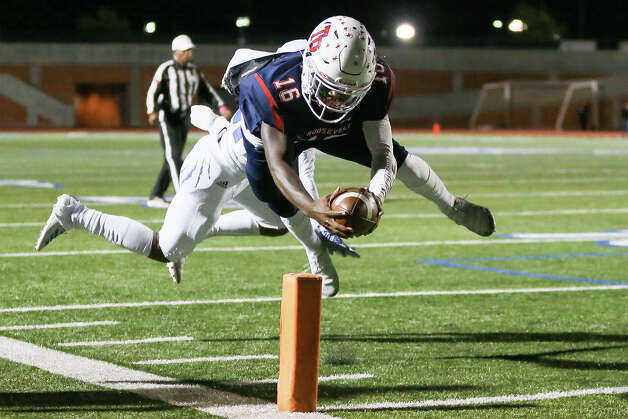Roosevelt's Dewayne Coleman dives towards the pylon on a six-yard touchdown run past South San's Jonathan Camacho in the second half in their District 27-6A high school football game at Heroes Stadium on Friday, Oct. 11, 2019. Roosevelt beat South San 46-0. Photo: Marvin Pfeiffer / Express-News 2019