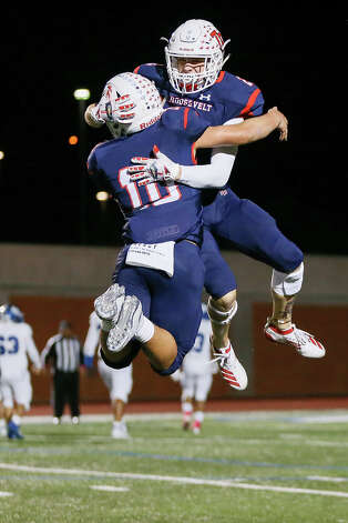 Roosevelt's Landon Foster, right, and Josiah Carillo leap into the air to celebrate a Rough Rider fumble recovery in the second half in their District 27-6A high school football game with South San at Heroes Stadium on Friday, Oct. 11, 2019. Roosevelt beat South San 46-0. Photo: Marvin Pfeiffer / Express-News 2019