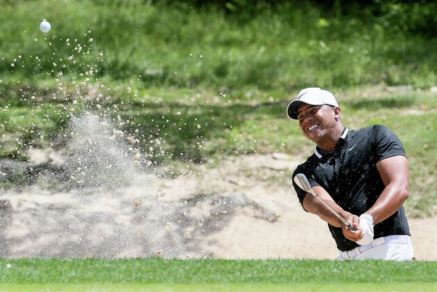 Jhonattan Vegas from Maturin, Venezuela, hits out of the bunker on the second hole during the first round of the Valero Texas Open at TPC San Antonio on Thursday, April 4, 2019. Vegas shot a five-under 67 on the first day of the tournament. Photo: Marvin Pfeiffer / Express-News 2019