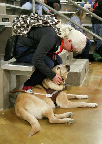 Melissa Padron, a graduate of Harlandale High School, sits with Cameo, her eight-year-old labrador retriever guide dog, at a Guide Dogs for the Blind meeting at Madison High School on Sunday, March 31, 2019. Photo: Marvin Pfeiffer / Express-News 2019