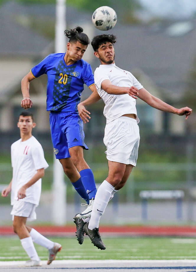 Judson's Humberto Villarreal, right, fights for a header with Clemens' Samuel Martinez during the first half of their District 26-6A boys soccer game at Lehnhoff Stadium on Friday, March 22, 2019. Clemens beat Judson 3-2. Photo: Marvin Pfeiffer / Express-News 2019