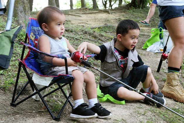 Hi'ilei Stevens, left, 1, waits for a bite while fishing with her brother, Ha'aheo Stevens in Live Oak's annual Junior Fishing Day for children ages 13 and under at Live Oak Park on Saturday, June 1, 2019. Photo: Marvin Pfeiffer / Express-News 2019