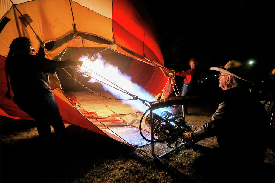 Bruce Lavorgna of Austin inflates his hot air balloon, Aerodactyl, at the Skylight Balloon Fest on the River City Community Church grounds in Selma on Saturday, Oct. 26, 2019. The three day event featured nightly balloon glows, morning balloon launches, tethered balloon rides, parachute jumps by the RE/MAX Skydiving Team, concerts and a family fun zone. Photo: Marvin Pfeiffer / Express-News 2019