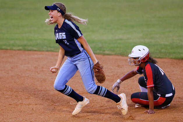 Johnson's Ally Oyanguren, left, celebrates after forcing out Judson's Keely Williams at second base during the third inning of their UIL Class 6A second-round high school softball playoff game at Northside ISD softball field No. 2 on Thursday, May 2, 2019. Judson advanced to the next round with a 4-2 victory over Johnson in the one-game series. Photo: Marvin Pfeiffer / Express-News 2019