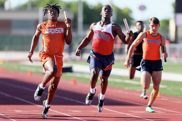 Madison's Brenden Ward, left, and Roosevelt's Jalen Smothers stretch at the finish line of the boys 400-meter relay during the District 27/28 6A area track and field meet at Rutledge Stadium on Thursday, April 18, 2019. Madison beat Roosevelt by .01 second, winning with a time of 43.28 seconds. Photo: Marvin Pfeiffer / Express-News 2019