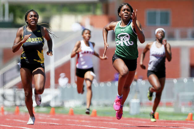 Reagan's Jasmine Montgomery, front right, approaches the finish line of the 6A girls 200-meter dash ahead of East Central's Ashlan Cannon during the second day of the Region IV-6A/5A track and field meet at Heroes Stadium on Saturday, April 27, 2019. Montgomery won the event with a time of 24.19 seconds. She also broke her own record in the 100-meter dash and ran the anchor leg on the Rattlers first place 400-meter relay. Photo: Marvin Pfeiffer / Express-News 2019