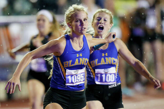Blanco's Carly Haack takes the handoff from Steely Steiner to start the second leg of the 3A girls 1600-meter relay during the UIL state track and field championships at Mike Myers Stadium in Austin on Friday, May 10, 2019. Blanco finished second in the event with a time of 3:56.63. Photo: Marvin Pfeiffer / Express-News 2019