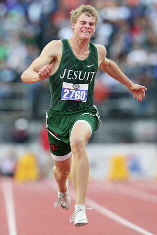 Houston Strake Jesuit's Matthew Boling strains as he crosses the finish line of the 6A boys 100-meter dash during the UIL state track and field championships at Mike Myers Stadium in Austin on Saturday, May 11, 2019. Boling set a new national record in the event with a time of 10.13 seconds, breaking the old record of 10.15 set by Greenville's Henry Neal in 1990. Photo: Marvin Pfeiffer / Express-News 2019