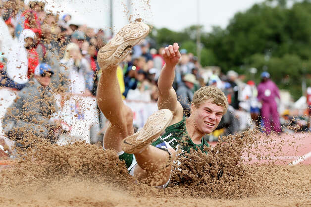 Houston Strake Jesuit's Matthew Boling lands in the pit in the 6A boys long jump during the UIL state track and field championships at Mike Myers Stadium in Austin on Saturday, May 11, 2019. Boling, the defending state champion, won the event with a jump of 25-04.50. Photo: Marvin Pfeiffer / Express-News 2019