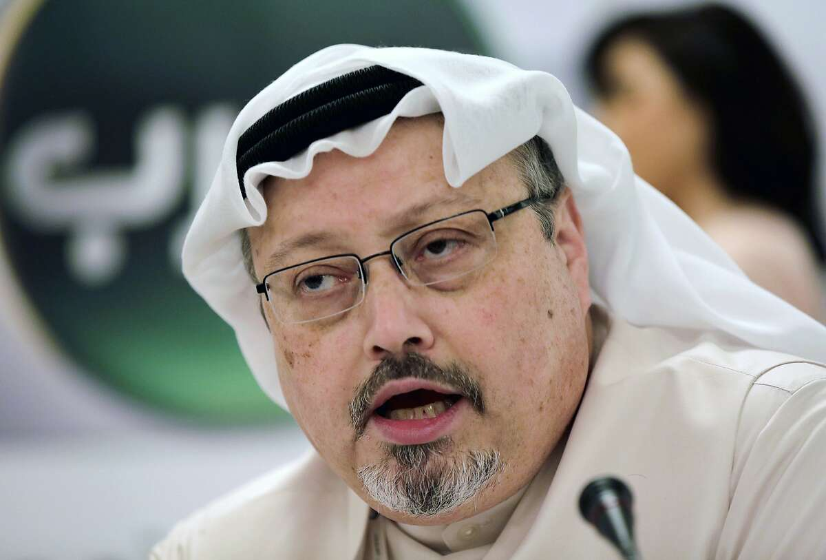 FILE - In this Dec. 15, 2014, file photo, Saudi journalist Jamal Khashoggi speaks during a news conference in Manama, Bahrain. A court in Saudi Arabia on Monday sentenced five people to death for the killing of Washington Post columnist Khashoggi, who was murdered in the Saudi Consulate in Istanbul last year by a team of Saudi agents. (AP Photo/Hasan Jamali, File)