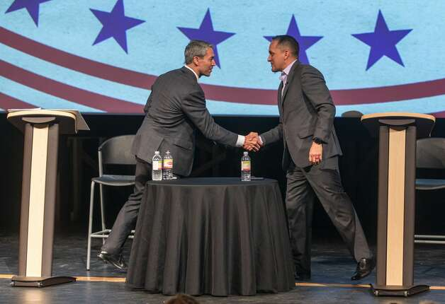 Mayor Ron Nirenberg, left, and Councilman Greg Brockhouse shake hands after participating Tuesday, April 9, 2019, in an AARP-sponsored mayoral candidate forum at Palo Alto College. Photo: William Luther