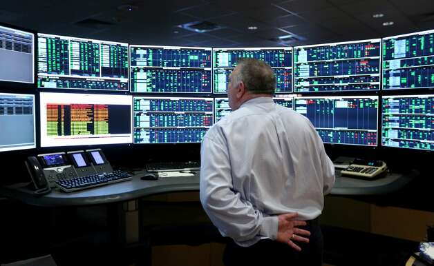 Control center senior manager Mark Carter examines screens Tuesday, April 23, 2019, at a work station in NuStar Energy L.P.'s pipeline control room. From the central location in NuStar's San Antonio headquarters, employees can monitor and control virtually every aspect of the company's pipelines including opening and closing valves and watching for any pipeline problems. Photo: William Luther/Staff Photographer