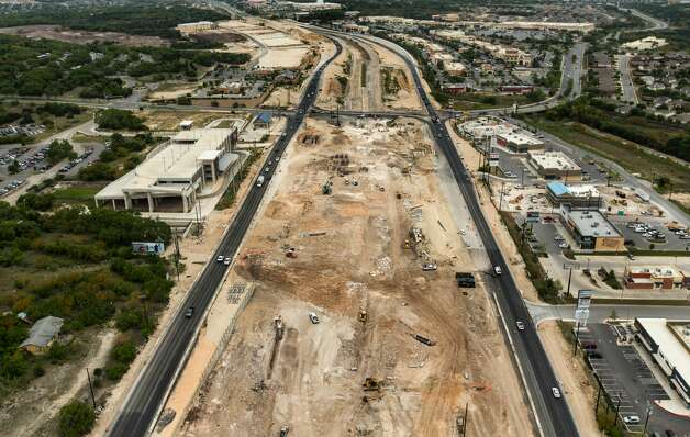Construction vehicles work Wednesday, April 3, 2019, on the expansion of US 281 near the intersection of of Stone Oak and TPC Parkways. Photo: William Luther