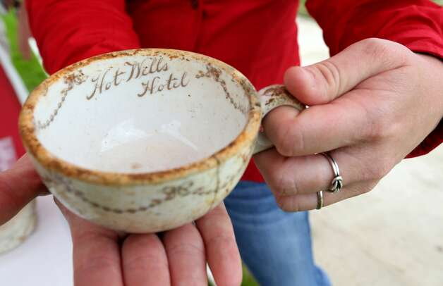 A Hot Wells Hotel tea cup recovered during the stabilization of the ruins of the former grand hotel is seen Tuesday, April 30, 2019, during the grand opening of the Hot Wells of Bexar County park. Photo: William Luther/Staff Photographer
