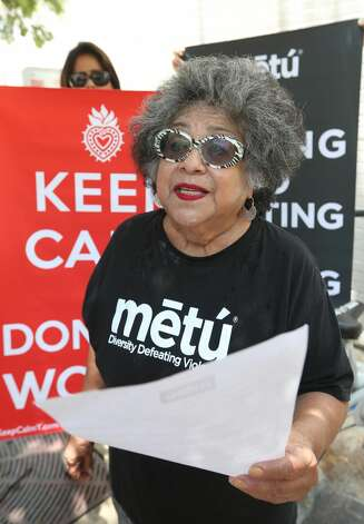 Ellen Riojas Clark, a co-organizer of Metu: Diversity Defeating Violence, reads a statement Wednesday, June 5, 2019, to the media during a news conference. The organization announced it filed a request with the Texas Rangers' Public Corruption Unit, asking the agency to formally investigate the disappearance of a police report regarding an alleged assault committed by mayoral candidate Greg Brockhouse. Photo: William Luther/Staff Photographer
