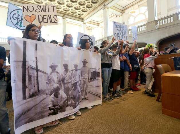 A large group of pre-teens and teenagers stand Thursday, June, 16, 2019, behind Susana Segura, at lectern, as she speaks in opposition to a proposed land swap near the Hays Street Bridge between the city and developer Mitch Meyer. City council voted 10-1 to approve the deal. Photo: William Luther/Staff Photographer