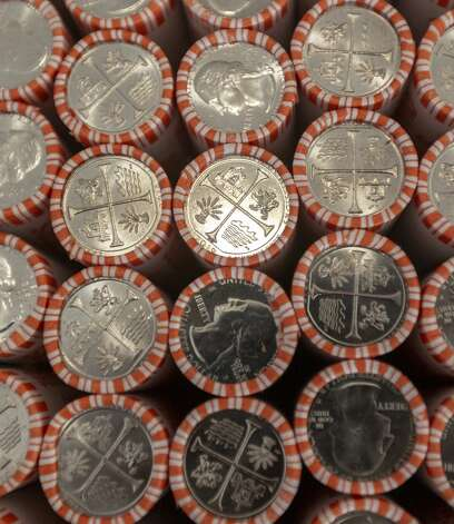 Rolls of San Antonio Missions National Historical Park quarters are seen Thursday, Sept. 5, 2019, at Trinity University as they are put into circulation during an event sponsored by the U.S. Mint. The coin, featuring images representing the historic San Antonio missions, is part of the Mint's America the Beautiful Quarters program which celebrates national parks or sites around the country. Consumers should start seeing the quarters in the near future as they make their way into circulation through banks around the country. Photo: William Luther/Staff