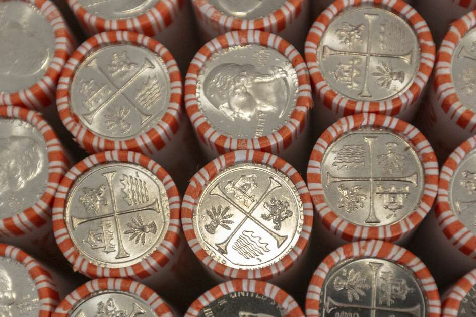 Rolls of San Antonio Missions National Historical Park quarters are seen Thursday, Sept. 5, 2019, at Trinity University as they are put into circulation during an event sponsored by the U.S. Mint. The coin, featuring images representing the historic San Antonio missions, is part of the Mint's America the Beautiful Quarters program which celebrates national parks or sites around the country. Consumers should start seeing the quarters in the near future as they make their way into circulation through banks around the country.