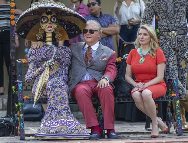 Robert 'Dick' Tips, left, jokingly puts his arm around a day of the dead decoration while his wife, Kristin sits next to him Thursday, Sept. 12, 2019, at La Villita during a news conference announcing a new city-sponsored Day of the Dead celebration. Photo: William Luther/Staff