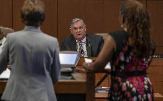 San Antonio city council member Clayton Perry, center, discusses possible changes Thursday, Sept. 19, 2019, at city council chambers to the city's paid sick leave ordinance with assistant city manager Colleen Bridger, left, and Danielle Hargrove, chair of the Paid Sick Leave Commission. Photo: William Luther/Staff