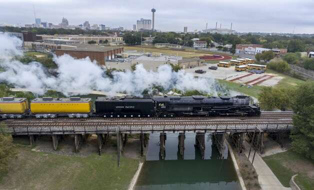 Union Pacific steam train No. 4014 makes its way Tuesday, Nov. 5, 2019, across the San Antonio River on it's way to Sunset Station east of downtown. Engine No. 4014 is one of 25 so-called Big Boy locomotives built for Union Pacific and the only one still operating, according to a Union Pacific press release. At 133 feet long it is longer than three school buses and it's 16 drive wheels are more than 5 feet in diameter. It was refurbished over two years by Union Pacific to celebrate the 150th anniversary of the first transcontinental railway, which was completed May 10, 1869, according to Union Pacific. Photo: William Luther/Staff