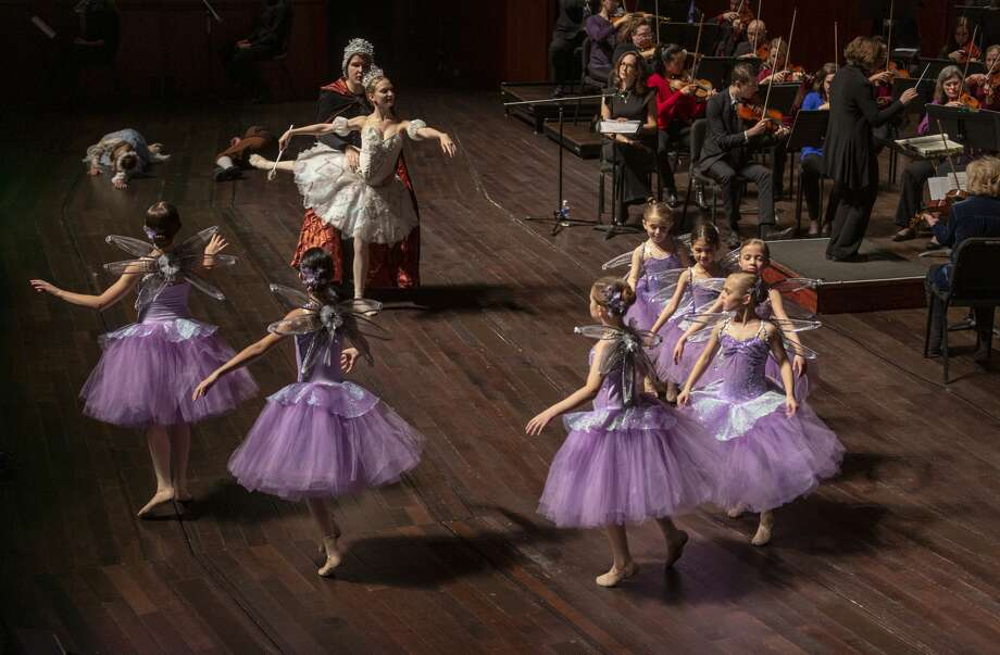 """Dancers from ChildrenÕs Ballet of San Antonio perform with the San Antonio Symphony Wednesday, Dec. 18, 2019, and other arts organizations at the Tobin Center for the Performing Arts during a show for QWILL Media and Education, a language arts program designed to give youngsters exposure to the arts and to develop their writing skills. The show was an adaptation of Shakespeare's """"A Midsummer Night's Dream."""" Photo: William Luther/Staff"""
