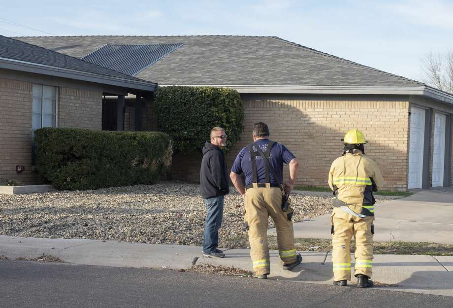 Midland fire fighters respond to a smoke call in townhomes at the corner of Wadley Ave and Whitney Drive 12/23/19 morning. Fire officials determined a ceiling light fixture had burned out, burning some insulation in the attic causing the smoke. They also stated no one would be displaced from the residence because of the fire. Tim Fischer/Reporter-Telegram Photo: Tim Fischer/Midland Reporter-Telegram