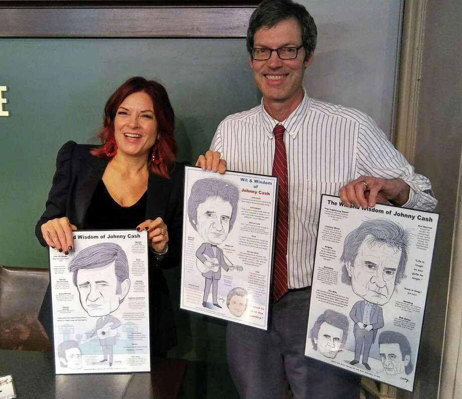 Artist Robert Carley with the caricatures of country music legend Johnny Cash he presented to Cash's daughter Roseanne Cash. Photo: Robert Carley / Contributed Photo /