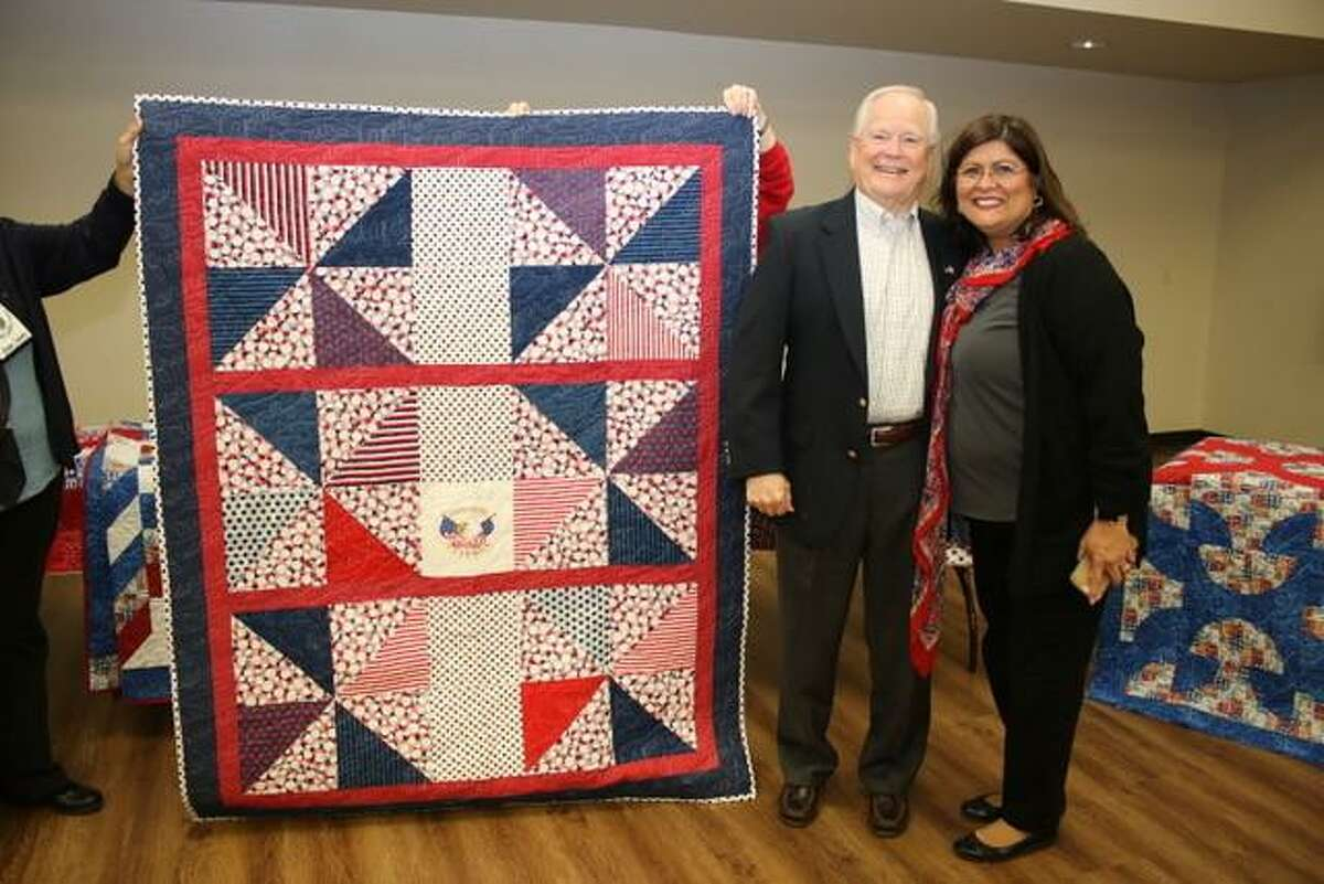 Cecil Eugene Jones, Army, Sergeant is presented quilt. He's pictured with Mary Olivarez, member of the Golden Needles Quilt Guild.