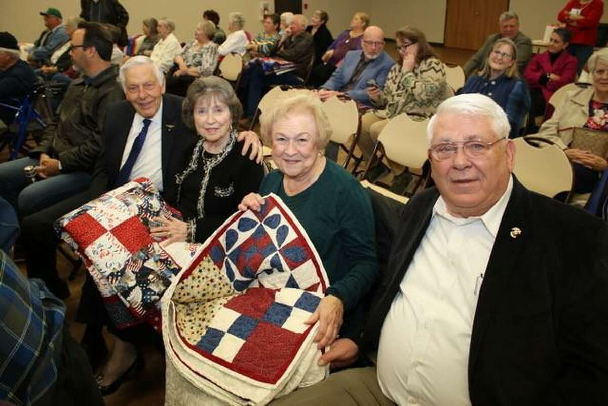 Pictured from left to right Paul Edward Martin, (LCDR), US Navy Lt Commander with wife, Betty Lou Martin and Jerry Gilbert Smith, US Marine Corp Corporal with wife Joyce Smith. The former service members received quilts from the Golden Needles Quilt Guild.