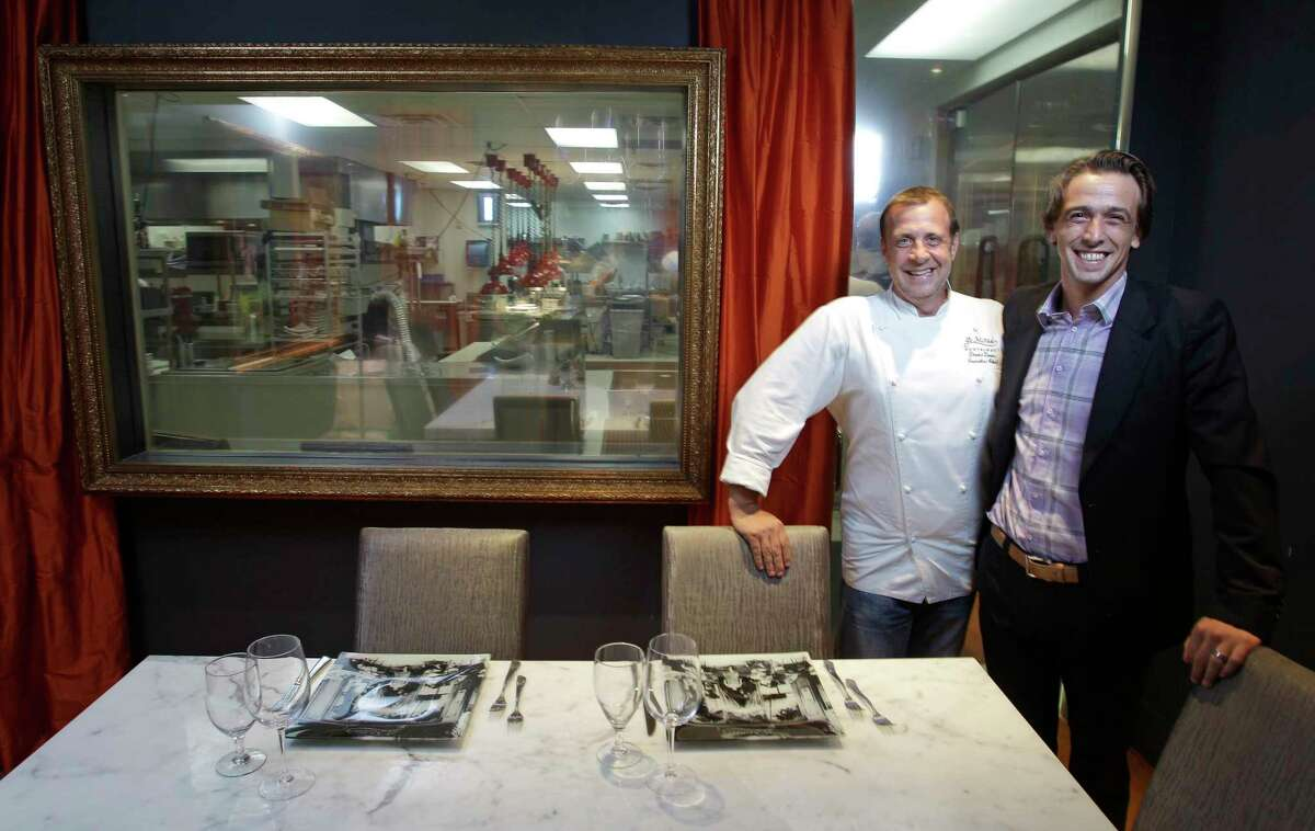 Chef David Denis, left, and his brother, Sylvain Denis, right, general manager and co-owner at the chef's table in Le Mistral, 1400 Eldridge Pkwy., marking the restaurant's 10th anniversary.