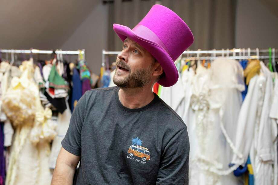 National Youth Theater instructor, Justin Parks, poses with theatrical hats, Friday, Dec. 20, 2019. Parks works with a plethora of children teaching soft skills such as singing, dancing, public speaking and problem solving. Photo: Gustavo Huerta, Houston Chronicle / Staff Photographer / Houston Chronicle