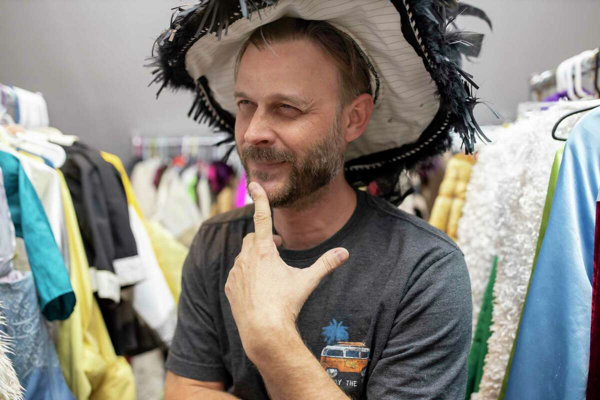 National Youth Theater instructor, Justin Parks, poses with theatrical hats, Friday, Dec. 20, 2019. Parks works with Wildwood Methodist Church assisting with productions played by youth churchgoers.