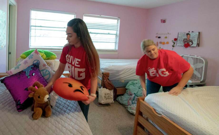 Rosaura Martinez, left, and Kelsey Wells with Mattress Firm put sheets and toys back onto beds after replacing the mattresses Tuesday, March 12, 2019 at the Treehouse Center in Conroe. Mattress Firm donated 25 mattresses to the center. Photo: Cody Bahn, Houston Chronicle / Staff Photographer / © 2018 Houston Chronicle