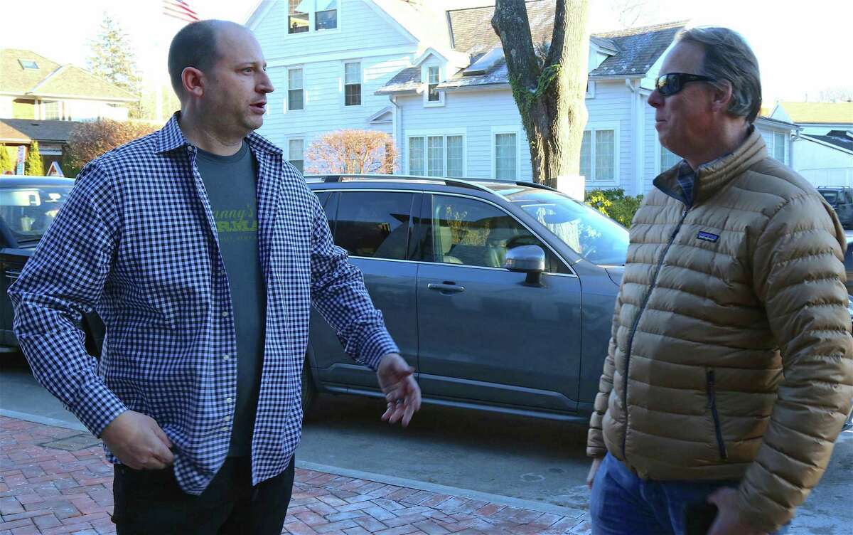 Griff Conti, left, owner of the new franchise of Franny's Farmacy, which will open in June, chats with Brian Edmonds, co-founder of New England Hemp Farm, the first hemp store to open in Westport earlier this year, at the pop-up store foreshadowing Conti's upcoming store on Church Lane on Dec. 20, 2019, in Westport