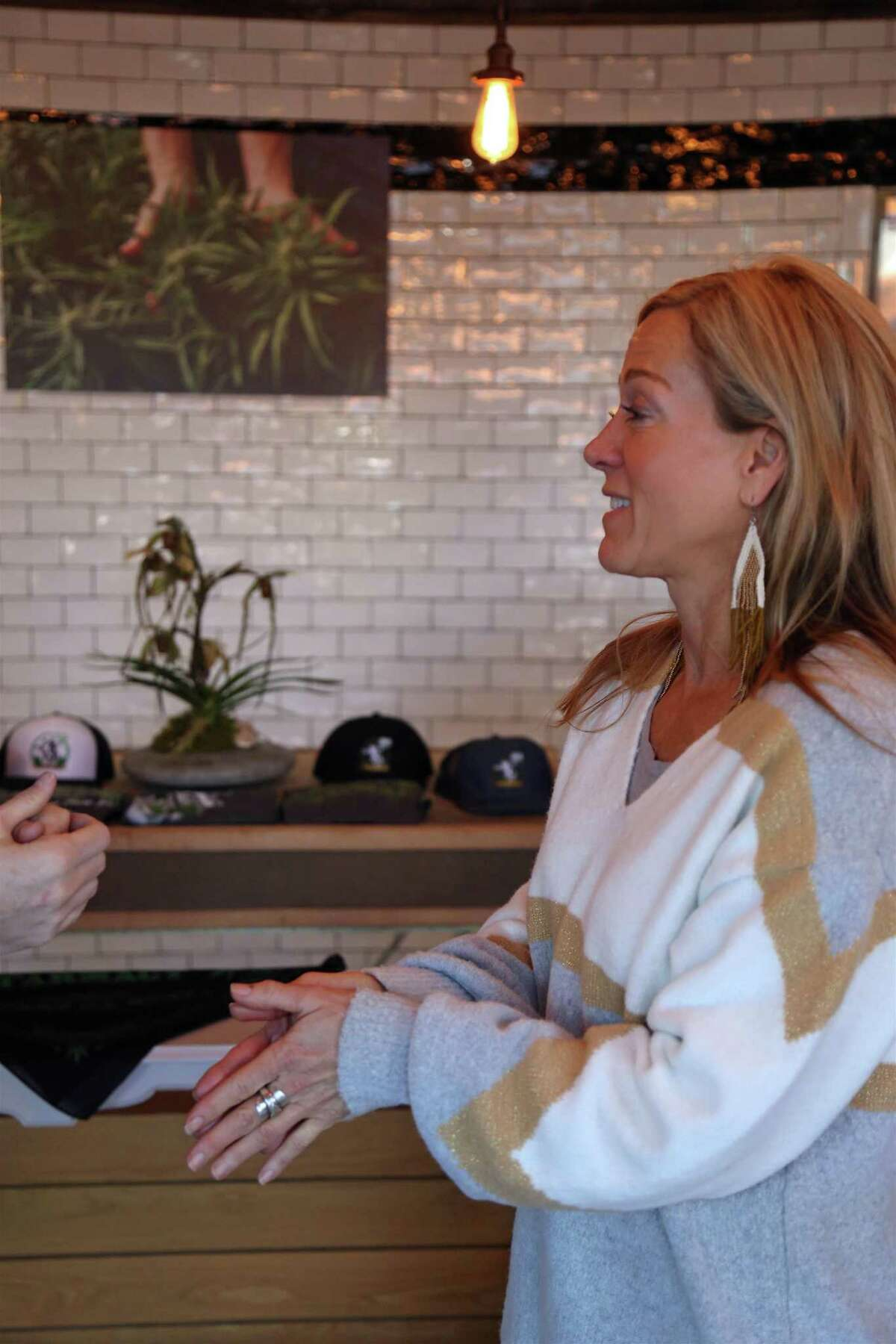 Franny Tacy, founder of Franny's Farmacy in Asheville, N.C., chats with a customer at the pop-up store foreshadowing her new Westport franchise on Church Lane on Dec. 20, 2019, in Westport.