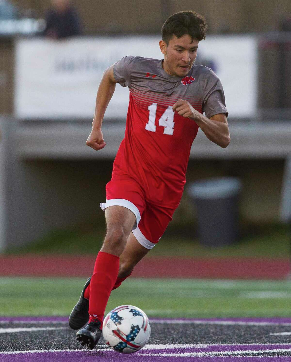 Hector Villegas #14 of Splendora dribbles the ball in the first period of a high school soccer match during the Kat Cup at Berton A. Yates Stadium, Saturday, Jan. 5, 2019, in Willis.
